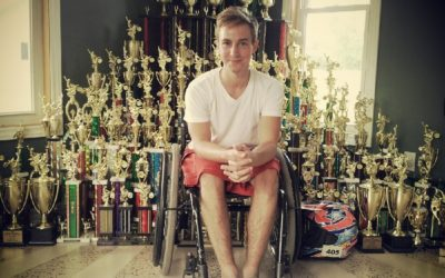 Paul-in-wheelchair-with-trophies